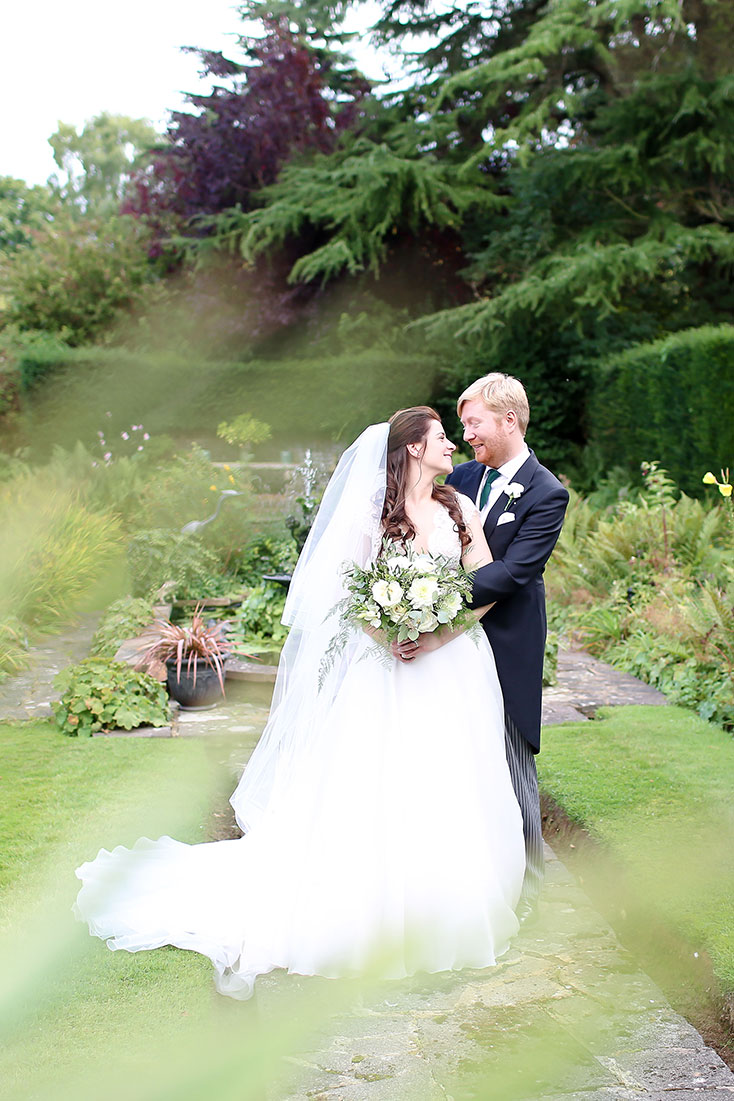 64efa4220a25 Charlotte wearing Suzanne Neville for a relaxed, outdoorsy Surrey wedding